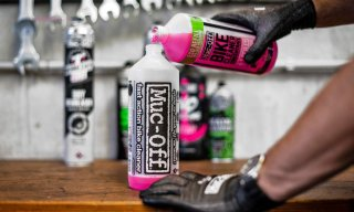 Muc-off cleaner being refilled